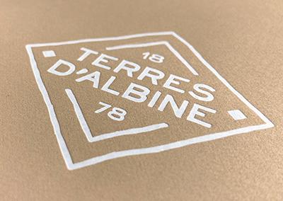 Logo en forme de blason pour l'entreprise Terres d'Albine
