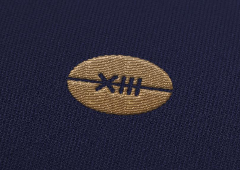 Broderie du logo sur les vêtements de la marque Anselme